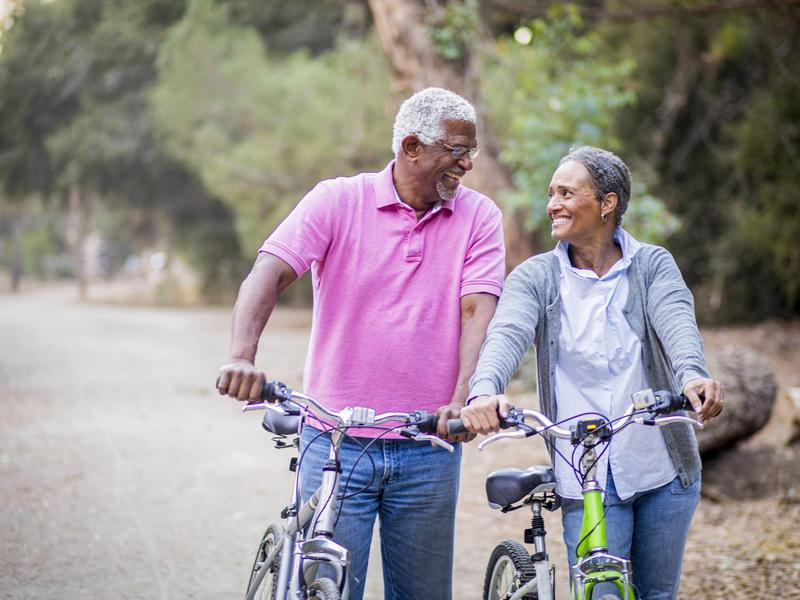 Couple walking with bicycles