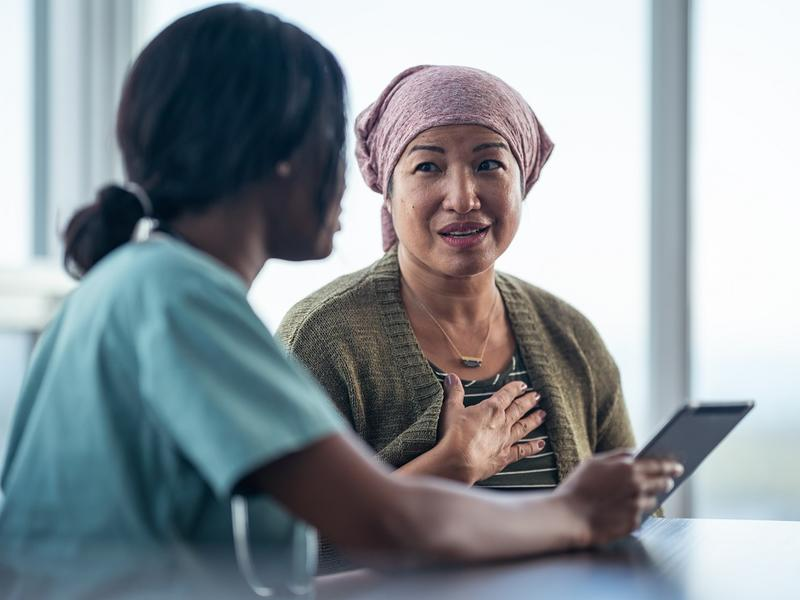Woman cancer patient talking to doctor.
