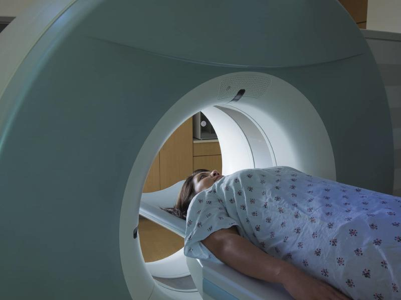 person going inside ct imaging machine