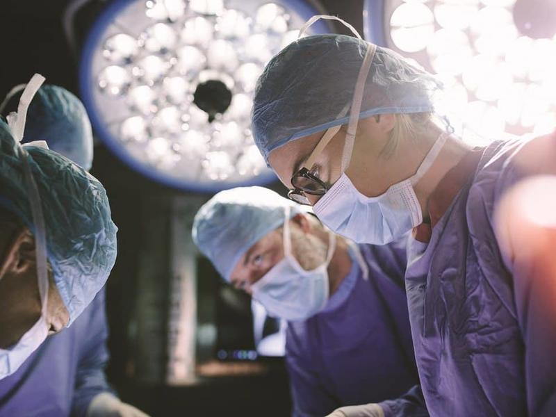 CAMC doctors performing Neurosurgery