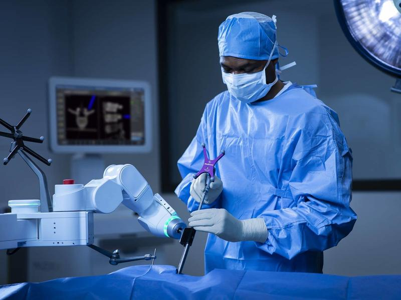 A CAMC Doctor performing a Robotic spine surgery
