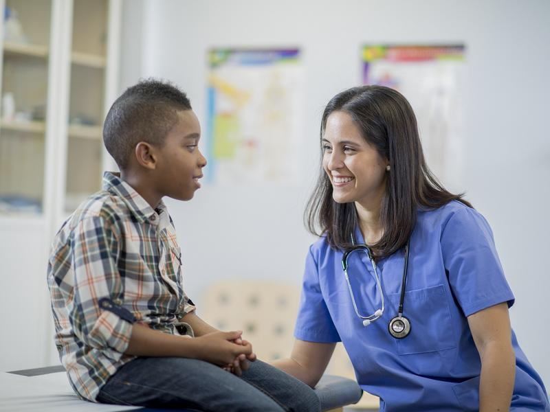Nurse talking with child