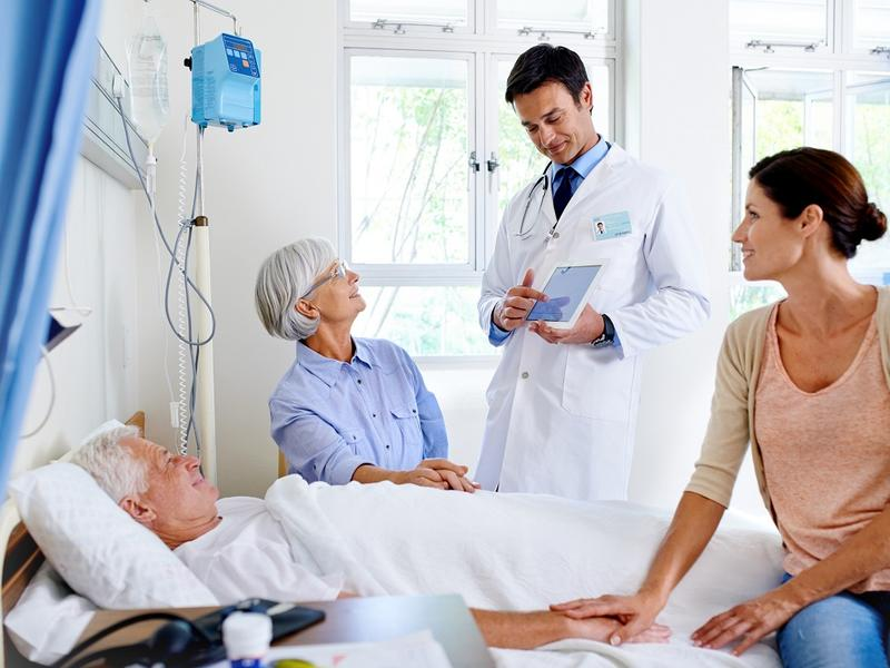 Doctor talking with patient and family