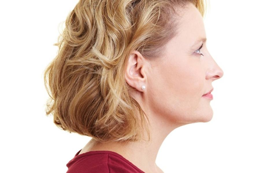 Side profile view of a woman's face.